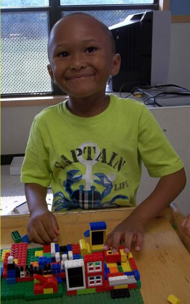 Prekindergarten Classroom - Jayden Enjoying LEGO Bricks
