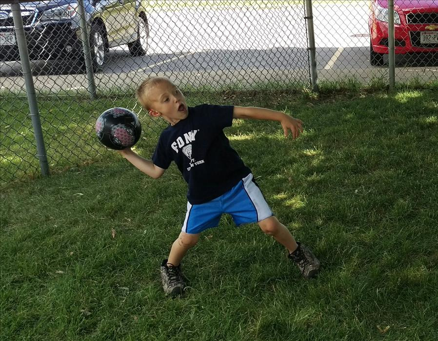 School agers get to practice their coordination skills outside as they play catch!