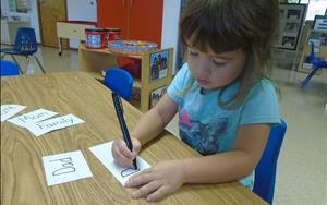 Our Pre-K friends are learning to write theme-related words.