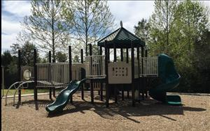 Our beautiful fenced playgrounds offers shaded areas and equipment for children to play and enhance their gross motor skills!