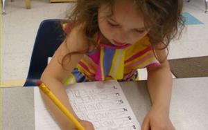 Prekindergarten student, Esme, practicing her name
