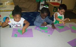 Preschoolers Making Dinosaurs Using Shapes