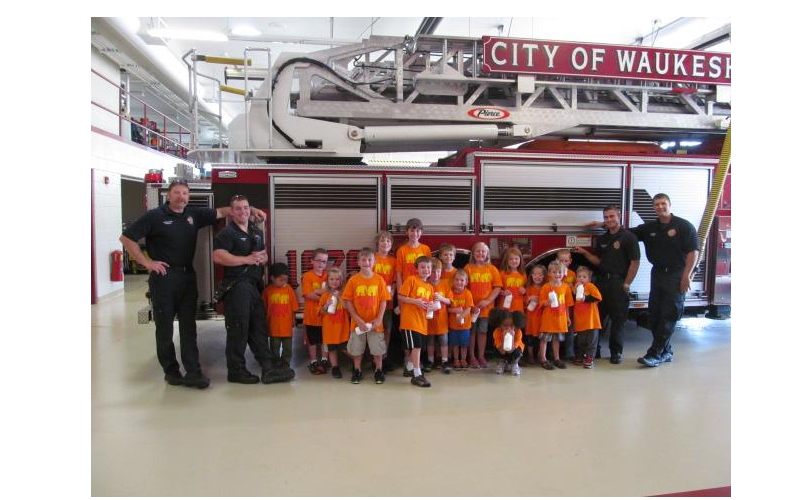 Our school-age children having a blast at the local fire department.