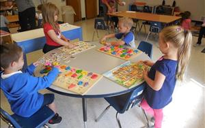 Puzzles are a great way to review alphabet sounds with our PreKindergarten friends.