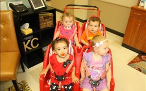 Toddlers going on a center field trip as part of their new curriculum activities.