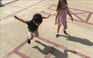 Anthony and Ava playing with their shadows.