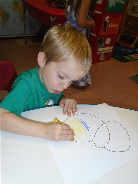 Simple projects like coloring help develop a child's cognitive and fine motor skills.