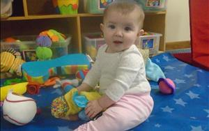 In the Infant Classroom, we are working on hand-eye coordination.