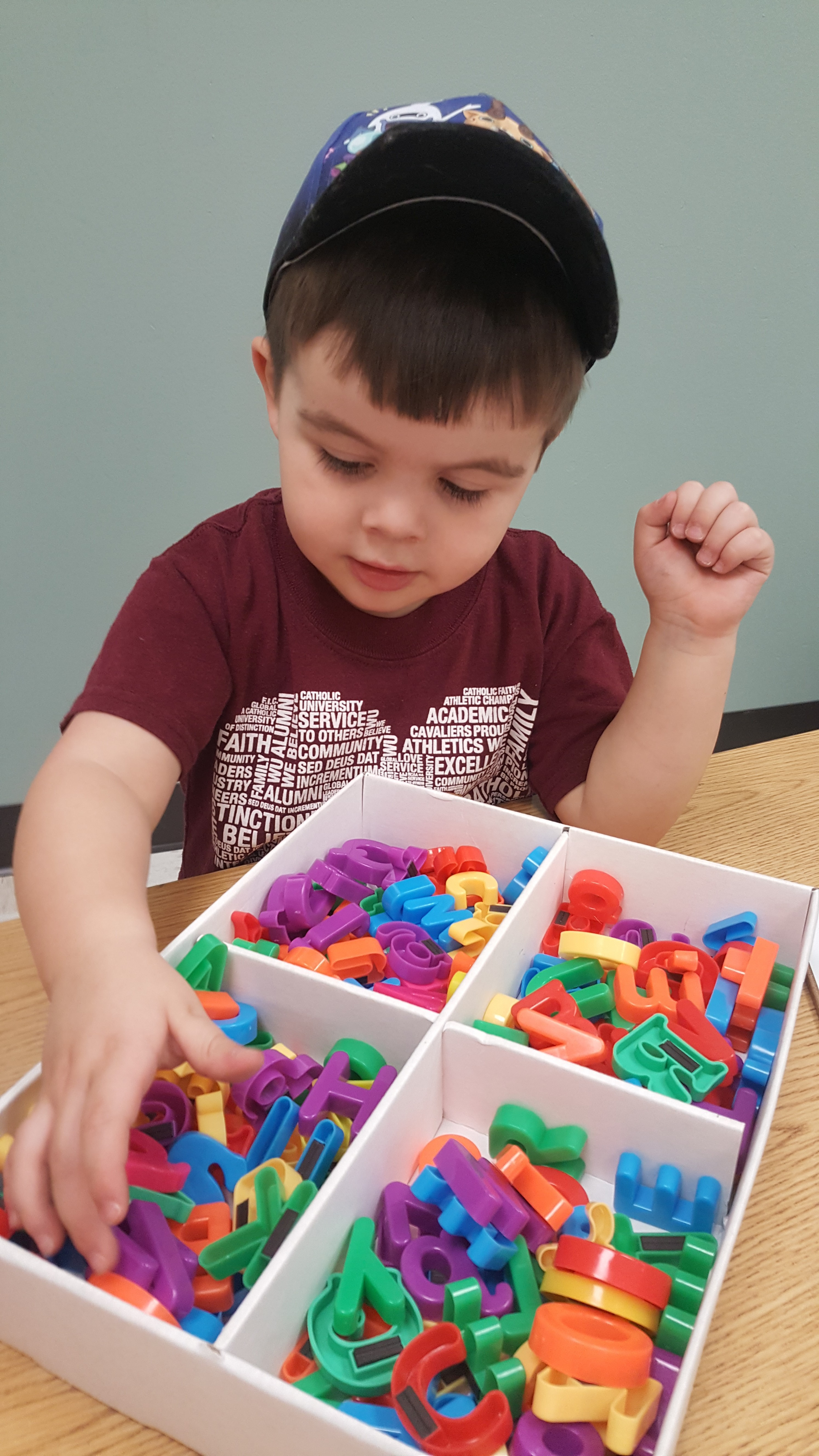 This child is enjoying his Phonics Adventure. He is working on letter recognition by fishing for the letter F!