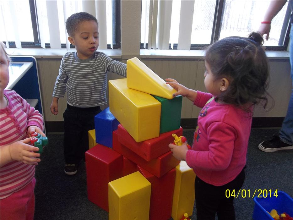The children in our Discovery Preschool class learn cooperative play while building with blocks.