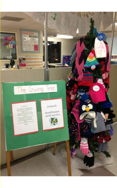 Our Giving Tree, our mittens and hats that we are donating.
