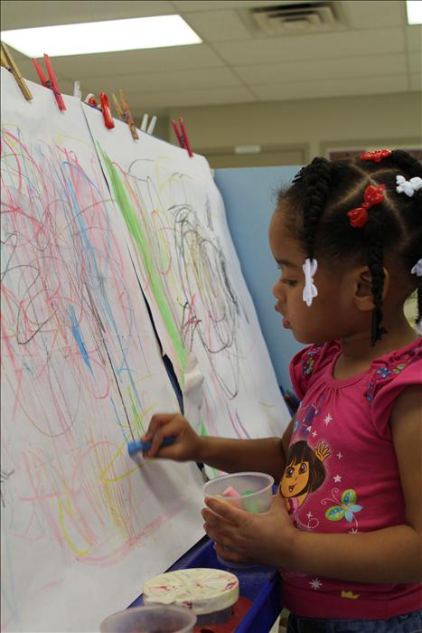 Creativity sparks the interest of all of our children at the easel!