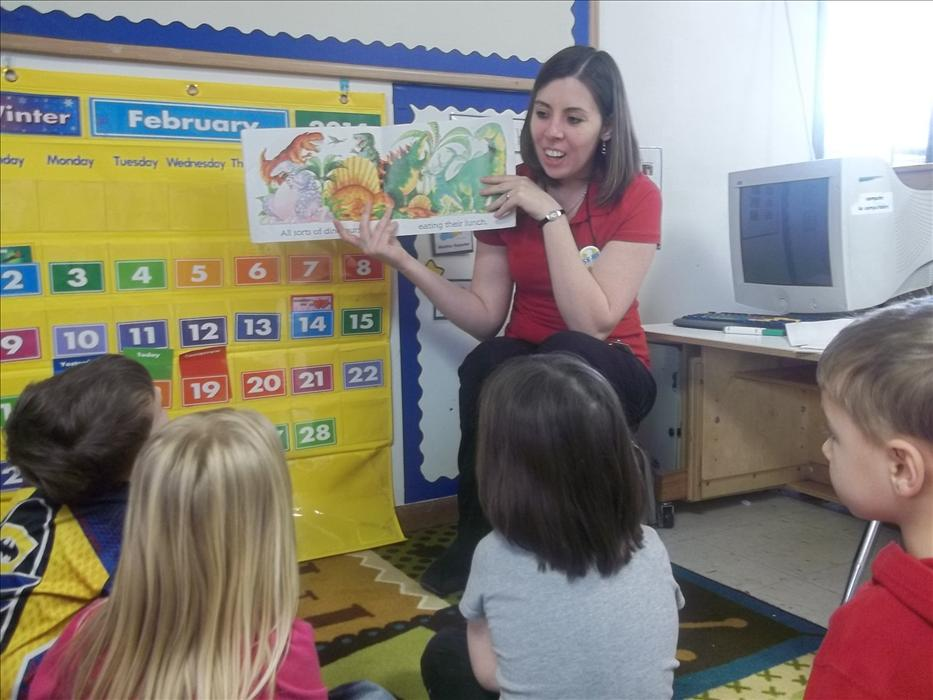 Ms. Melody reads a book to her Prekindergarten Classroom.