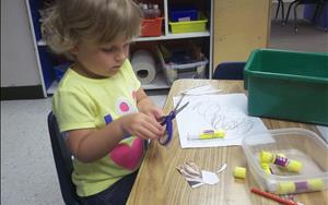 Learning to cut in the Preschool Room.