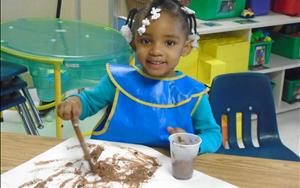 Painting with mud was messy fun in our Discovery Preschool Room.
