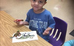 Our Prekindergarten class exploring the world of dinosaurs by creating and painting a 3-D dino display for our Museum Gallery!