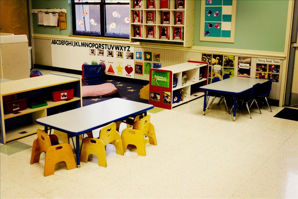 Our toddler room lends plenty of learning areas to enhance social and gross motor skills.