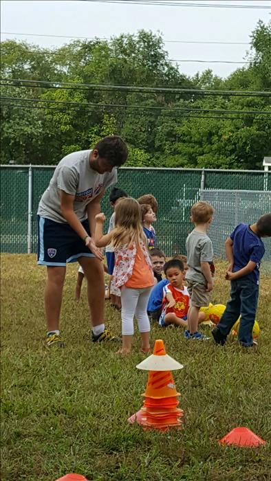 Our friends from Mini Kickers taught us how to play Soccer!
