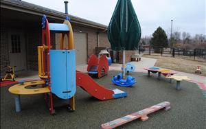 Infants, toddlers and discovery preschoolers have a large and inviting playground for outside time.