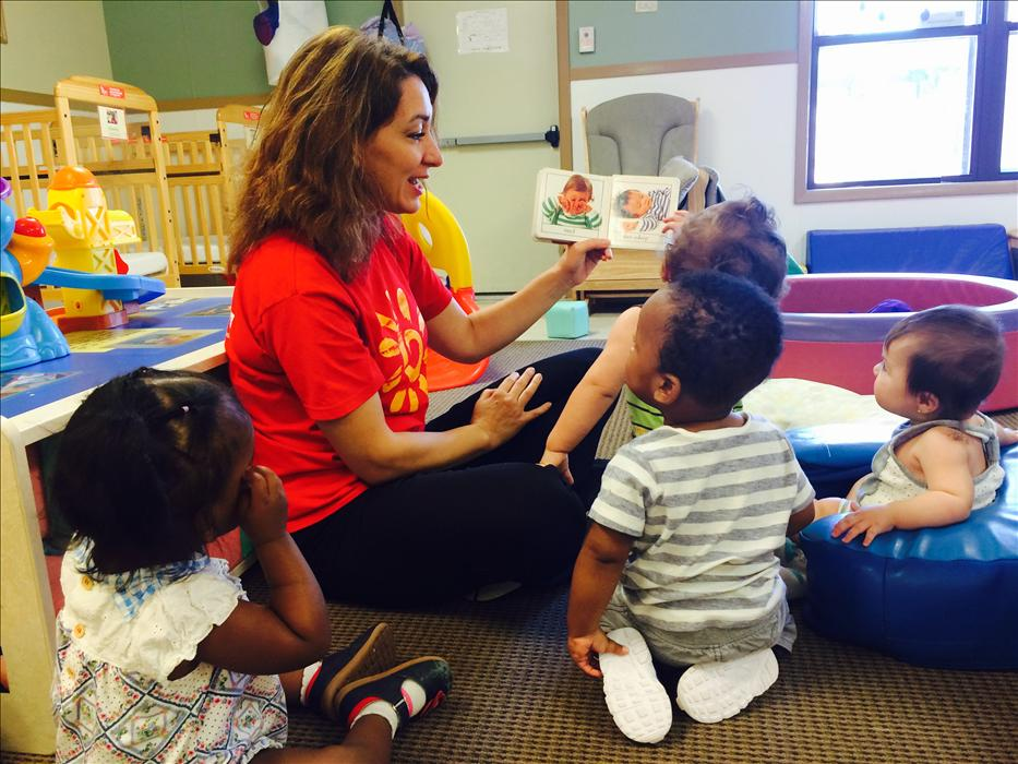 Our Infant teachers help promote early language development by talking with our babies, singing songs, and reading books.