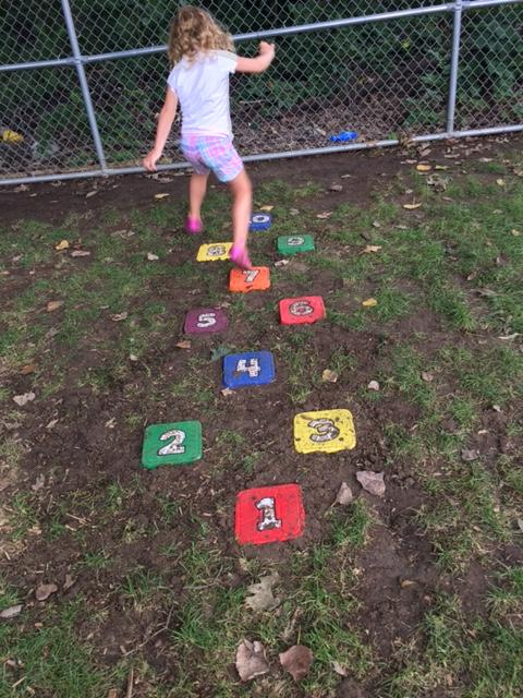 Preschoolers helped to make our playground hopscotch and are clearly proud of it as they recall making it to parents and staff weekly.