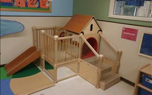 Our Toddler classroom climber is great for building large motor skills.