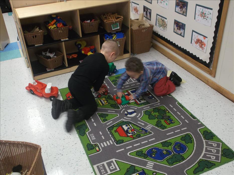 Two of our preschool students having races through town.