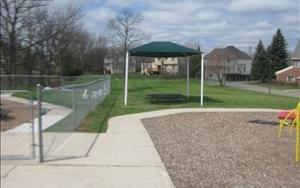 Our large fenced in playground allows for great large motor outdoor experiences.