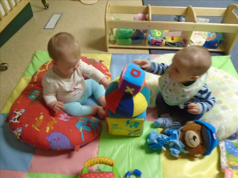 Infants playing together
