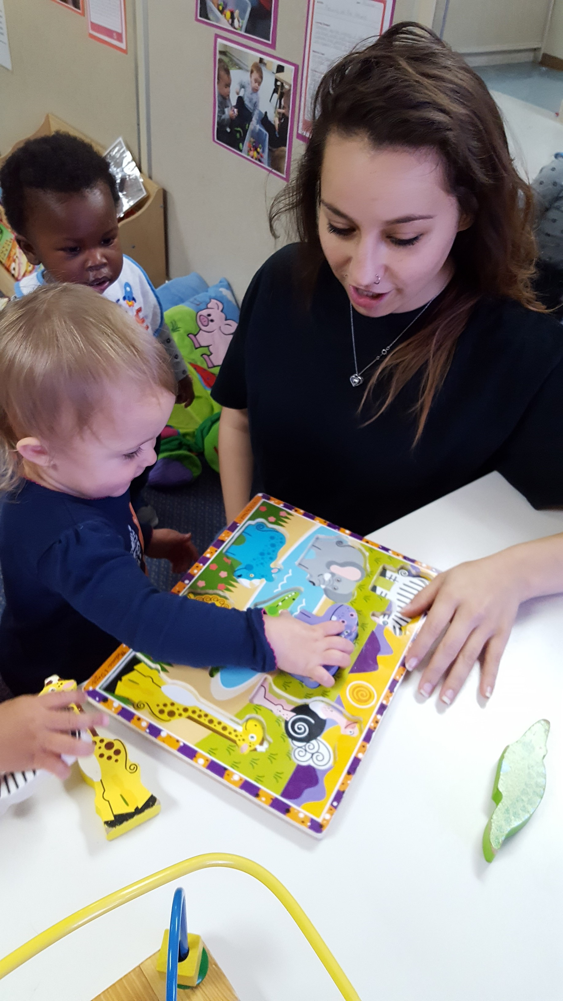 Working on matching skills in the Toddler Classroom.