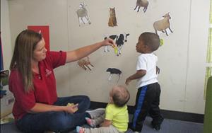 Mrs. Amber having fun with the children matching the magnets to the animals!