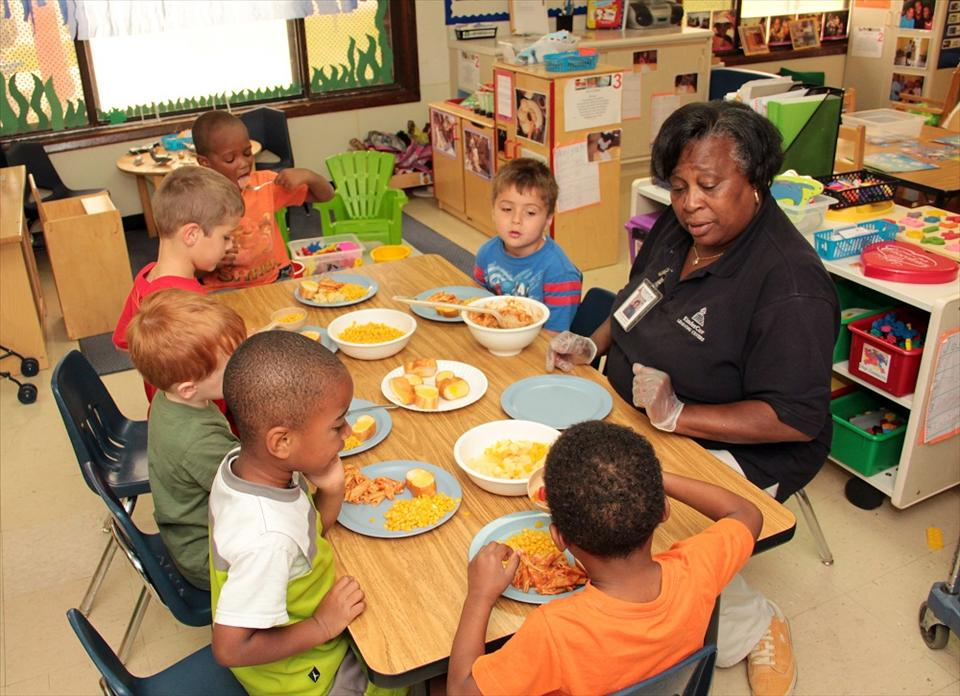 Here at KinderCare we participate and encourage Family-Style dining where the children learn to serve, share and prepare meals together.