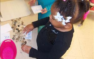 Our Juniour Kindergartners stepped back into time during our Dinosaur unit! Here, a child enjoys writing her name in stones in our prehistoric writing center!