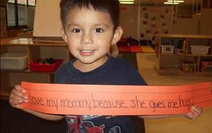 Our two-year-olds are exposed to writing at a young age. Our teachers write on a sentence strip, what the children have said and post throughout the classroom.