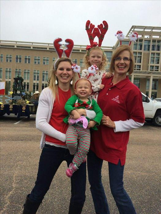 Center Director Pam Anders celebrates holiday's with staff and families at community parade