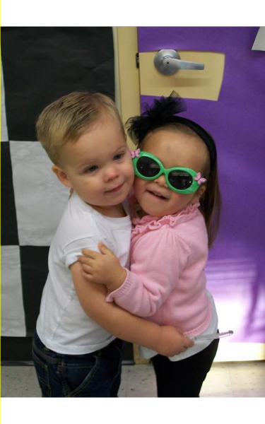 A Toddler and Two-year-old are celebrating the 50th day of school with a 50's style sock hop!