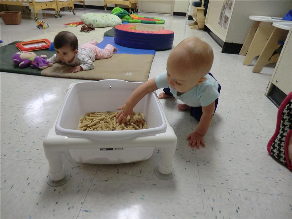 "Our Infant class had fun playing in the ""Oodles of Noodles"" during the ""What's The Weather"" theme."