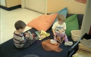 Reading books is always fun in the Toddler room!