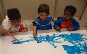 Our toddlers working on their fine motor skills using paintbrushes.