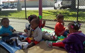 Our toddlers enjoyed eating their snack outside during their picnic!