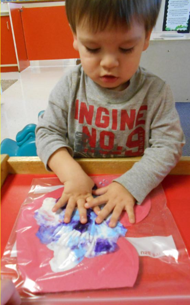 Toddlers making butterflies in class