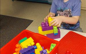 Building blocks are a great way to foster cognitive growth in child development, including math skills and fine-motor skills.