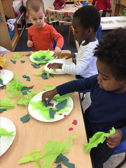 Discovery Preschool tossing their healthy salad