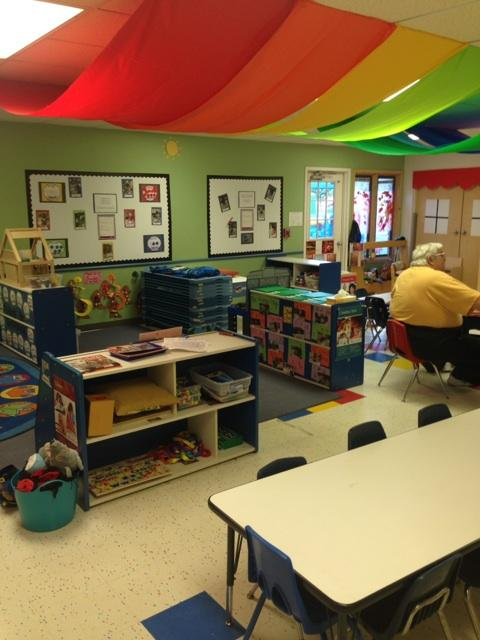 Our rainbow ceiling flowing through our Preschool classroom