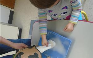 "Our Toddler Students learn about ""Amazing Animals"" and one of their hands on activities is ""Milking a Cow""."