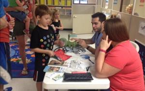 Getting his frog a check up by the Veterinarian from Bay Glen Animal Hospital at our KinderCare Health and Safety Fair.