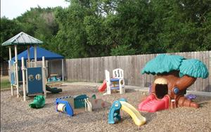 We have two playgrounds. This one is designed to be age appropriate for children ages two and under.  Each classroom has 30 minutes for outdoor play every morning and afternoon. This allows children to be able to play and not be crowed. Child directed play is still learning as teachers can make each moment a teachable one.