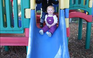 Playing outside on the Toddler playground