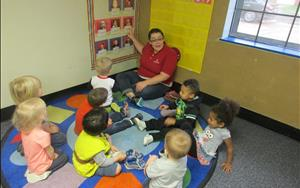 Our two-year-olds enjoy circle time with Ms. Dakota while learning about colors, shapes, the calendar, and weather.