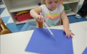 Using our fine-motor skills to make a picture of clouds.